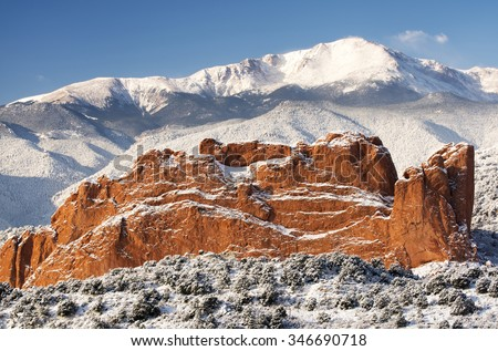A fresh winter snow covers Pike's Peak and The Garden of the Gods in Colorado Springs Colorado. #346690718