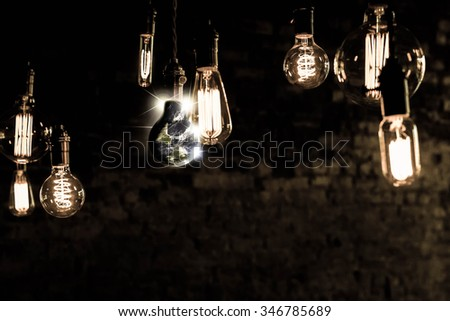Planet earth and lightbulb for global power and energy concept, Elements of image from NASA #346785689