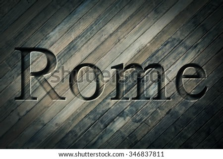 Engraving spelling the city Rome on textured old surface #346837811