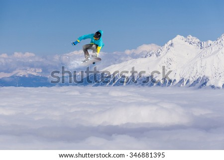 Flying snowboarder on mountains. Extreme winter sport. #346881395