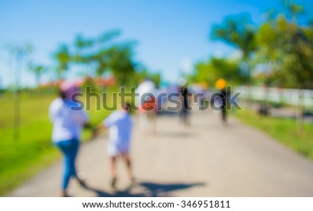 image of blur people walking on street with sunny day in green park for background usage . #346951811