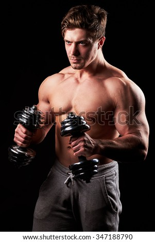 a young and fit male model posing his muscles #347188790