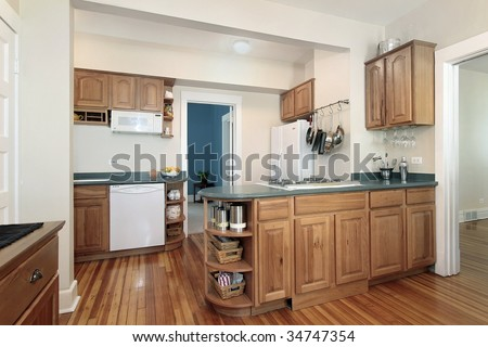 Kitchen with wood cabinetry #34747354