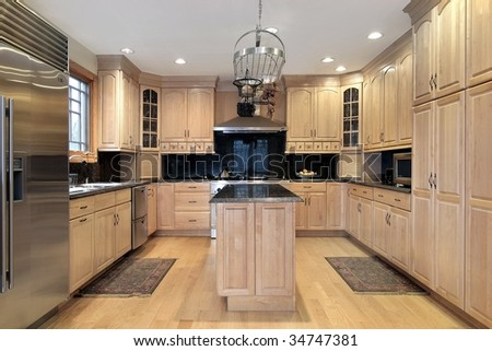 Kitchen with oak cabinetry #34747381