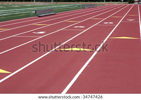Man walking on red numbered running track #34747426