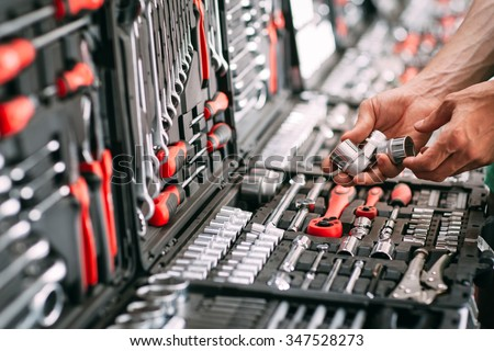 Customers or worker (builder, repairman, handyman) at the store chooses wrench (nuts) instrument (tools). Display of tools shop marketing for home and auto repair Royalty-Free Stock Photo #347528273