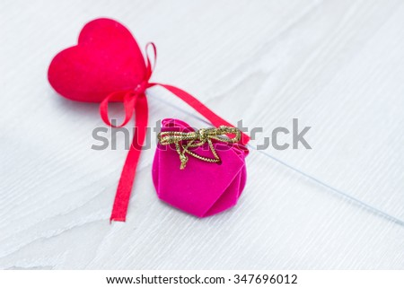 Valentines day gift box and hearts on wooden table with copy space #347696012
