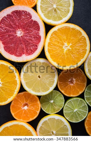 Fresh citrus fruits half cut, dark border background with copy space,from above #347883566