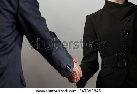 Handshake of business partners - man and woman #347895845