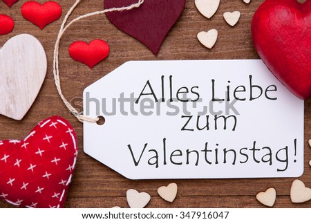 Label With Red Textile Hearts On Wooden Gray Background. German Text Alles Liebe Zum Valentinstag Means Happy Valentines Day. Retro Or Vintage Style. Macro Or Close Up Of One Label #347916047