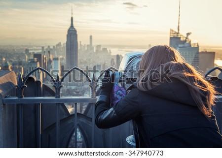 woman binocular new york #347940773
