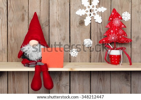 christmas decoration with antique toy over wooden background. retro style picture