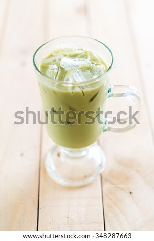 iced matcha latte on wood table #348287663