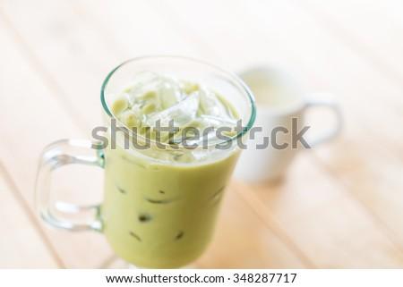 iced matcha latte on wood table #348287717