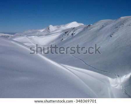 skitouring trail in white snow covered mountains in austria #348369701