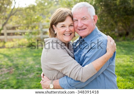 Happy senior mature couple in love outside in nature #348391418