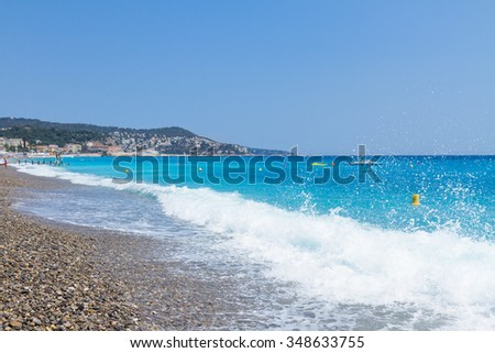 stone beach and turquiose water of cote dAzur at Nice, Riviera, France #348633755
