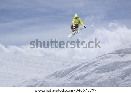 Flying skier on mountains. Extreme winter sport. #348673799