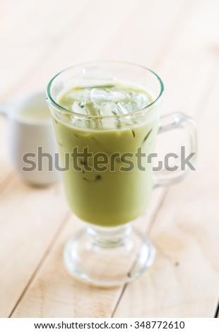 iced matcha latte on wood background #348772610