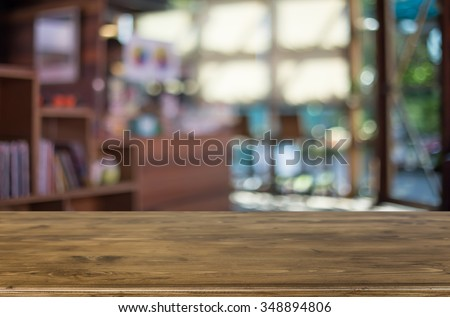 Selected focus empty brown wooden table and Coffee shop blur background with bokeh image. for your photomontage or product display #348894806