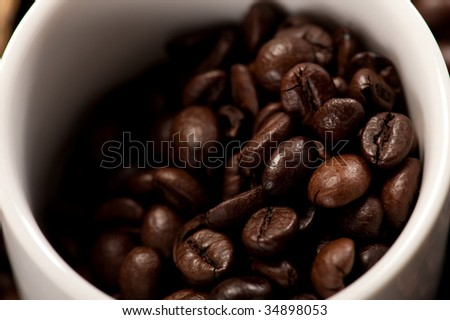 cup of coffee on coffee beans #34898053