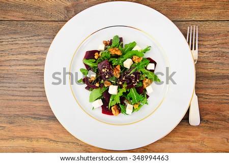 Arugula Salad, Boiled Beets, Cheese and Walnuts Studio Photo #348994463