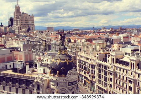 MADRID, SPAIN - MAY 10, 2013: Metropolis building on the Gran via. Famous building was constructed in 1911 by French architects Jules and Raymond Fevrier. #348999374