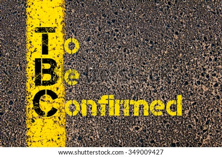 Concept image of Accounting Business Acronym TBC To Be Confirmed written over road marking yellow paint line. #349009427