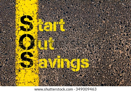 Concept image of Accounting Business Acronym SOS Start Out Savings written over road marking yellow paint line. #349009463