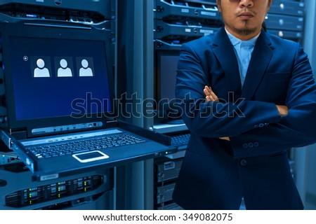 Man fix server network in data center room . #349082075