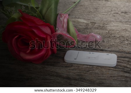 condom and red roses on wooden table background,Valentine concept #349248329