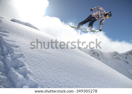 Flying snowboarder on mountains. Extreme winter sport. #349305278