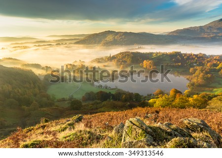 Autumn Fog Lingering Over Loughrigg Tarn In The English Lake District. #349313546