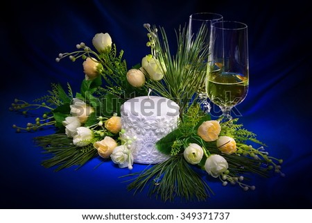 Christmas composition with fir branches, flowers, wine glasses and candles #349371737