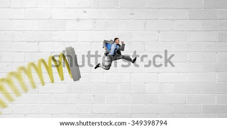 Businessman jumping on springboard as progress concept #349398794