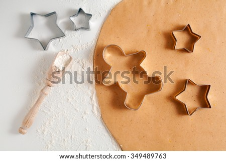 Homemade traditional gingerbread cookies dough preparation recipe on white kitchen table. #349489763