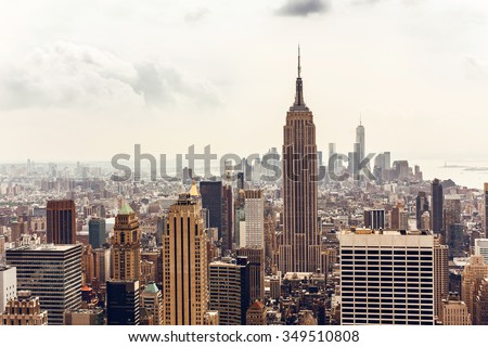 NEW YORK, USA - AUGUST 12, 2013: Manhattan aerial view with Empire State building in New York City. Empire State is a 102-story landmark and was world's tallest building for more than 40 years. #349510808
