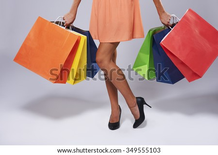 Low section of woman with paper bags #349555103