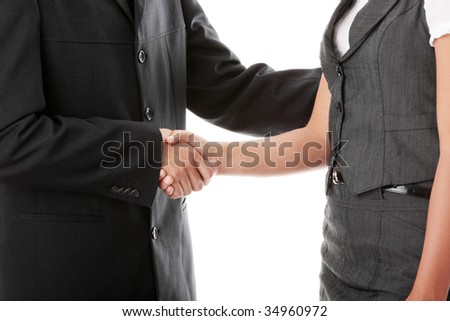 Young business couple handshaking isolated on white #34960972