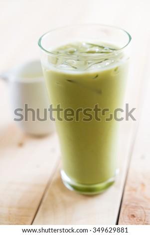 iced matcha latte on wood background #349629881