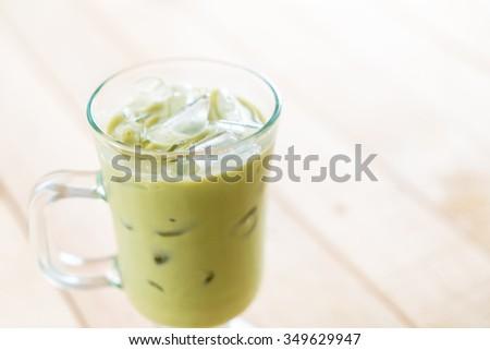 iced matcha latte on wood background #349629947