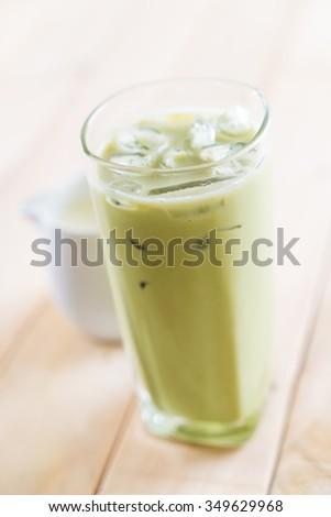 iced matcha latte on wood background #349629968