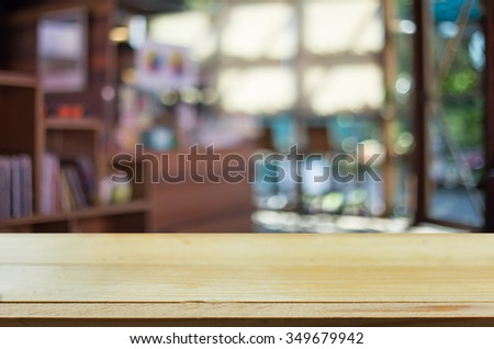 Selected focus empty brown wooden table and Coffee shop blur background with bokeh image. for your photomontage or product display #349679942