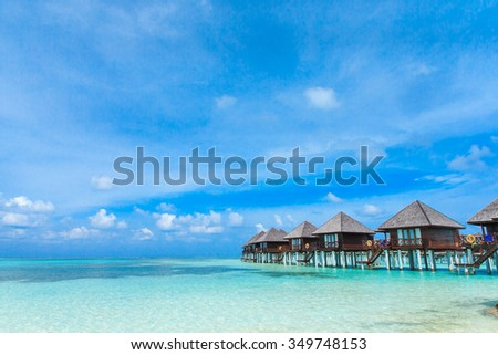 beach with water bungalows at Maldives #349748153