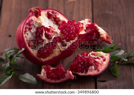 Pomegranates on rustic brown background #349896800