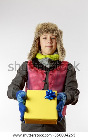 Boy presents a yellow packed present  #350004263