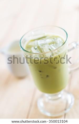 iced matcha latte on wood background #350013104