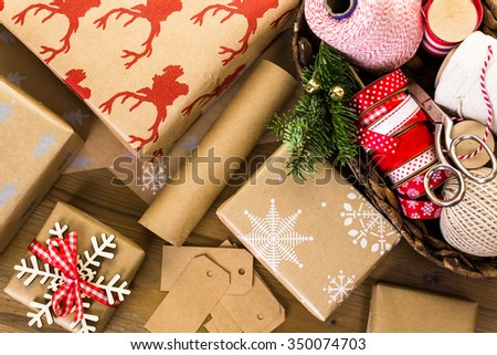 Christmas gifts wrapped in brown paper with red ribbons. #350074703