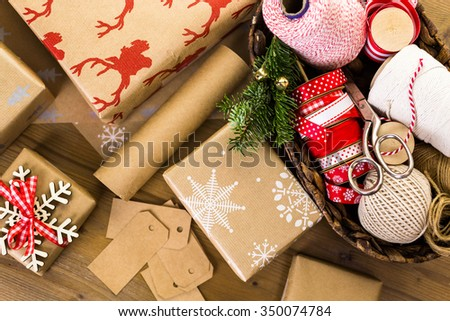 Christmas gifts wrapped in brown paper with red ribbons. #350074784
