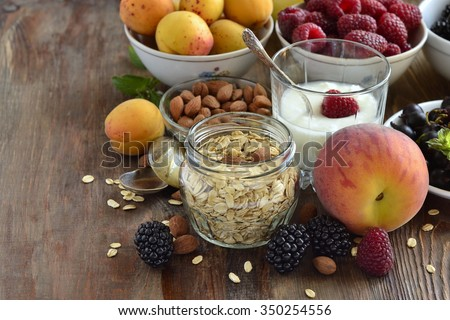 Cereals, almonds and various berries for breakfast, healthy nutrition #350254556